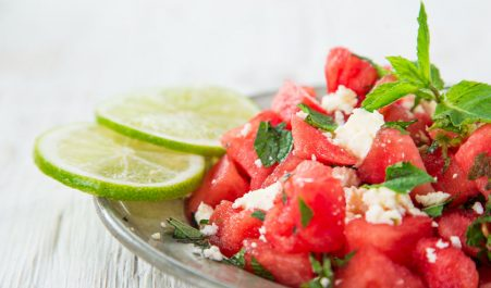 44545678 - fresh salad with water-melon, feta cheese, lime and mint, close-up.